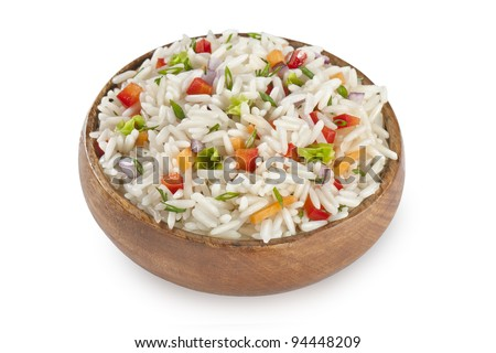 rice garnish in bowl with carrot, red peppers and tomatoes isolated on white
