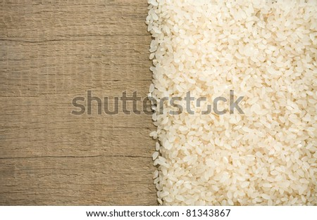rice grain and wooden background texture