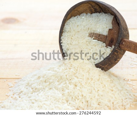 Rice grain on wood background.,Jasmine rice. #276244592