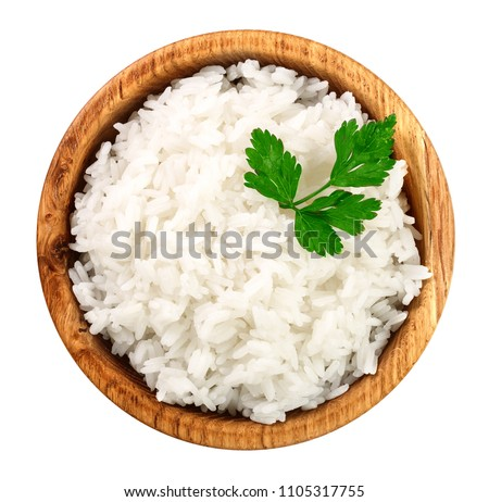 rice in a wooden bowl isolated on white background. Top view. Flat lay #1105317755