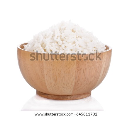 Rice in a wooden cup on a white background.