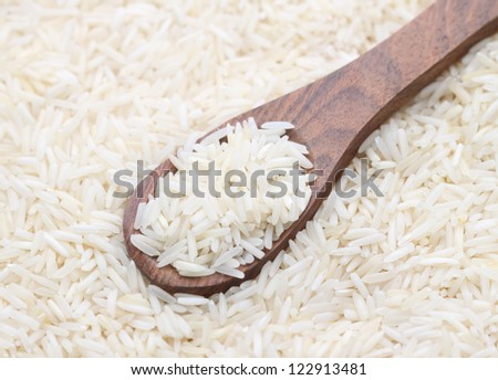 rice in a wooden spoon