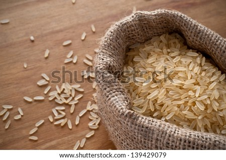 Rice in small burlap sack.