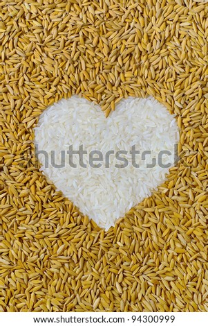 rice lover sign., pile of natural rice grains in heart or love shape