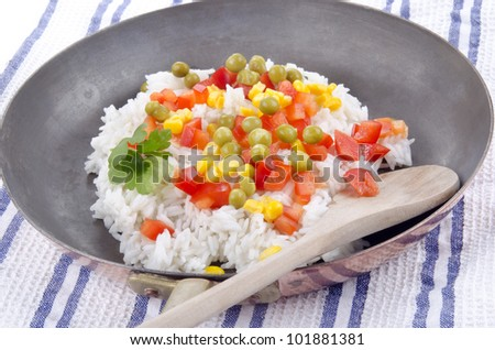 rice pan with diced red bell pepper, pea and sweet corn