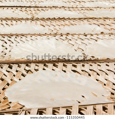 Rice paper drying at a bamboo frame , Vietnam - stock photo