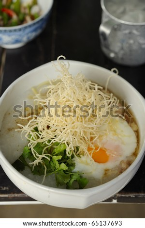 rice porridge - boiled rice with egg,noodle - stock photo