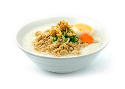 Rice Porridge with Minced Pork Served Boiled Egg ontop with Deep Fried Crispy Garlic Corainder and Spring onions Cutlet (Boiled Rice Thai Food Style) Decorate carved Carrot flower shape sideview
