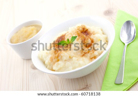 rice pudding and apple puree on table with spoon