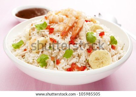 Rice salad with a mango vinaigrette dressing. Salad includes prawn or shrimp, roast chicken, banana, tomato and coriander. This is a great way to use leftover turkey.