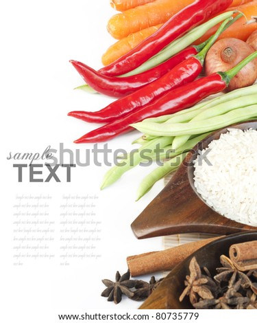 Rice, spices and fresh vegetables(red chili, green beans, carrot) With sample text