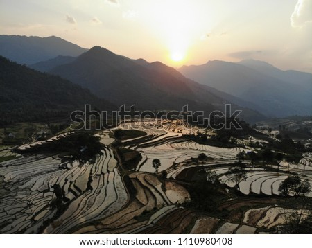 Rice terraces with water in Vietnam #1410980408