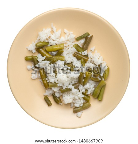 rice with asparagus beans on a light brown plate isolated on white background .healthy food . vegetarian food top view. Asian cuisine
