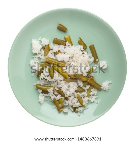 rice with asparagus beans on a light green plate isolated on white background .healthy food . vegetarian food top view. Asian cuisine