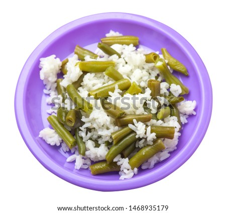 rice with asparagus beans on a purple  plate isolated  on white background .healthy food . vegetarian food top side  view. Asian cuisine