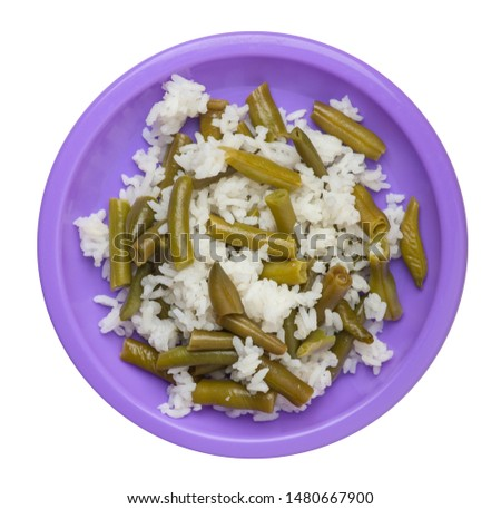 rice with asparagus beans on a purple plate isolated on white background .healthy food . vegetarian food top view. Asian cuisine