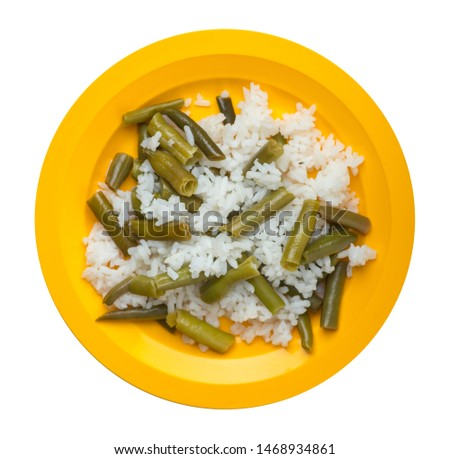 rice with asparagus beans on a yellow plate isolated  on white background .healthy food . vegetarian food top view. Asian cuisine