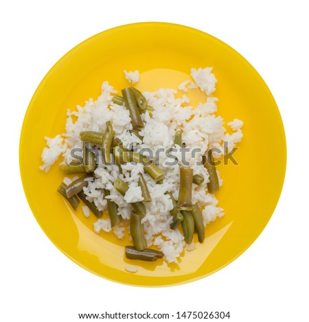 rice with asparagus beans on ayellow plate isolated on white background .healthy food . vegetarian food top view. Asian cuisine