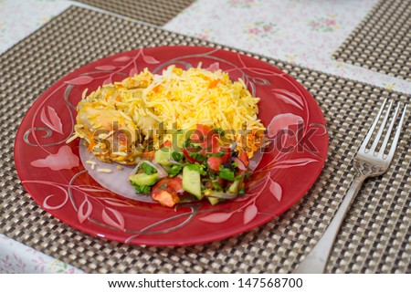 rice with chicken on a dining table
