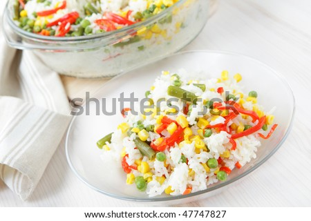 Rice with green peas, corn, runner bean, and red pepper
