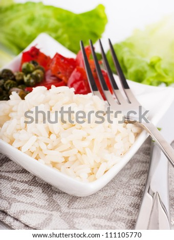 Rice with green-stuffs on a festive table - stock photo