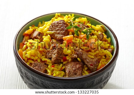 Rice with meat and carrot in a bowl