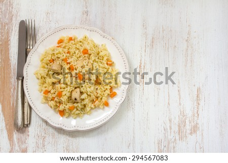 rice with meat and carrot on white plate on white background