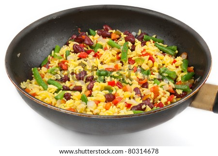 Rice with mix vegetables in a pan isolated on white background