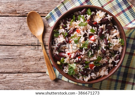 Shutterstock Rice with red beans and vegetables in a bowl on the table. horizontal view from above