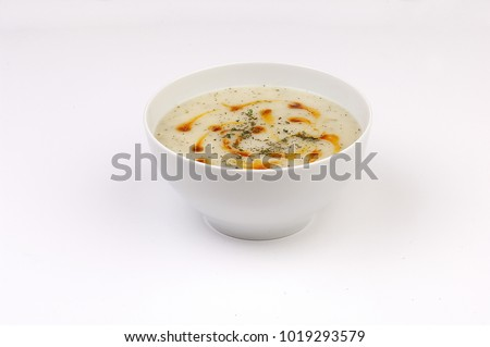 Rice, yoghurt and mint soup, traditional turkish food, is?kated on white #1019293579