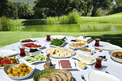 Rich and delicious Turkish breakfast on rounded table