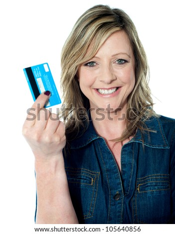Rich attractive lady showing credit card and smiling at camera
