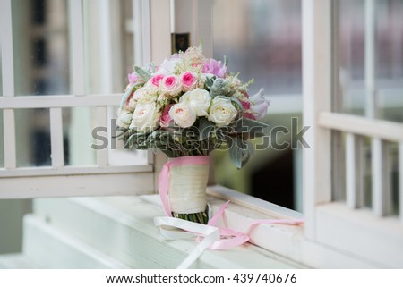 Rich bunch of pink peonies and lilac eustoma roses flowers, green leaf in the window. Fresh spring bouquet. Summer Background #439740676