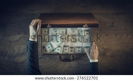 rich businessman opening a...