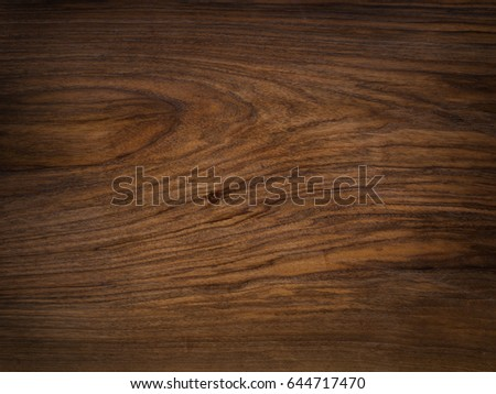 Rich chocolate-brown nutwood. Walnut wooden texture. Natural funiture material.