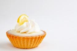 Rich creamy miniature lemon tart - shallow DOF, not isolated