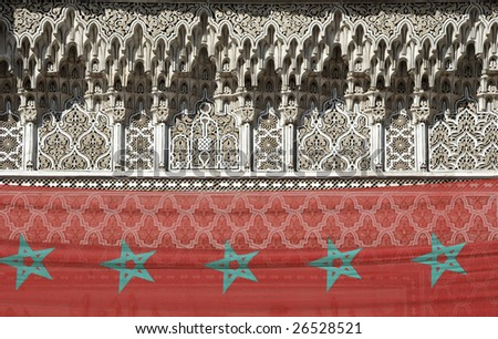 Rich decorated exterior of Marrakesh high school, Morocco. With Moroccan national flag