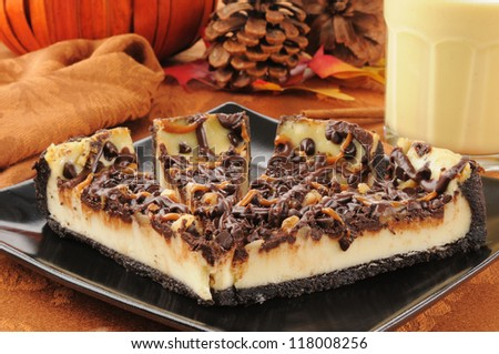 Rich delicious turtle cheesecake with pumpkin spice egg nog - stock photo