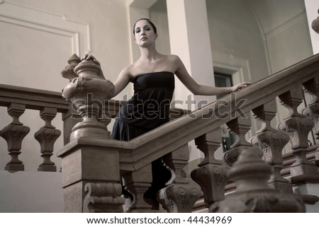 rich girl on a stairs