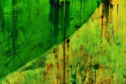 Rich green-orange painted metal wall with traces of rust, scratches, traces of dried green paint. A gloomy grunge background for your design.