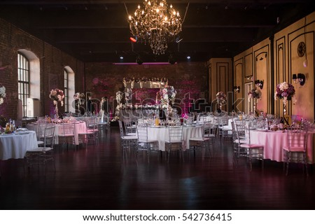 Rich large hall with round white tables prepared for wedding dinner Сток-фото ©