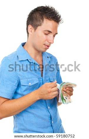 Rich man counts his money and standing in semi profile and smiling isolated on white background