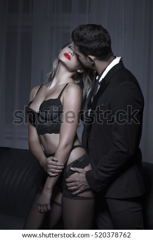 Rich man whispering young blonde lover in underwear, sensuality and desire