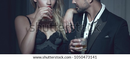 Rich man with lover with drink in night club, cinematic style #1050473141
