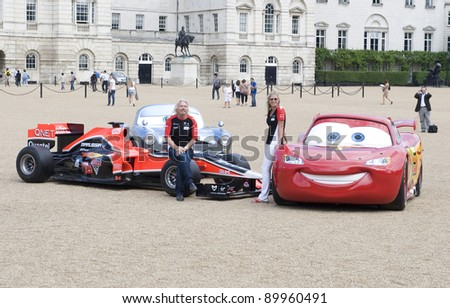 Richard and Holly Branson at a photocall to promote the new Disney Pixar Film Cars 2 with Marussia Virgin Racing. Horse Guards Parade London  04/07/2011 Picture by: Simon Burchell / Featureflash