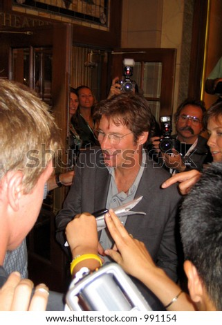 Richard Gere signing autographs at the Toronto Film Festival