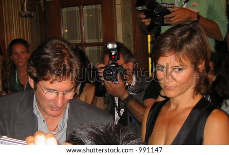 Richard Gere signing autographs at the Toronto Film Festival with wife Carey Lowell
