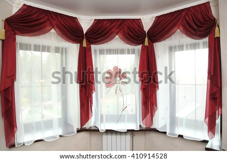 richly decorated curtain at windows in the room