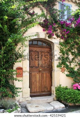 richly grained wooden door to...