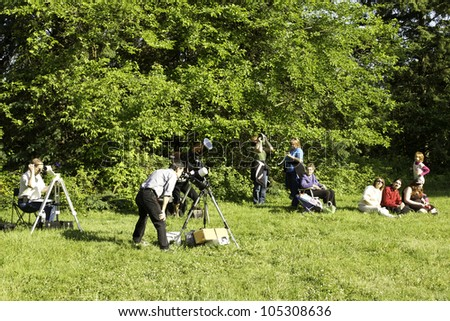 RICHMOND HILL, ONTARIO - JUNE 5: People watching Venus Transit at the David Dunlap Observatory on June 5, 2012 in Richmond Hill, Ontario, Canada